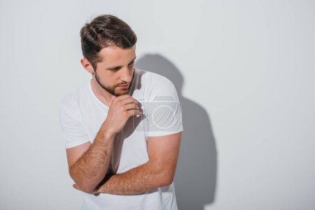 Photo for Thoughtful young man standing in pose and looking away - Royalty Free Image