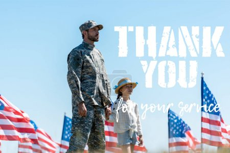 Photo for Cute kid holding hands with military father near american flags with thank you for your service illustration - Royalty Free Image