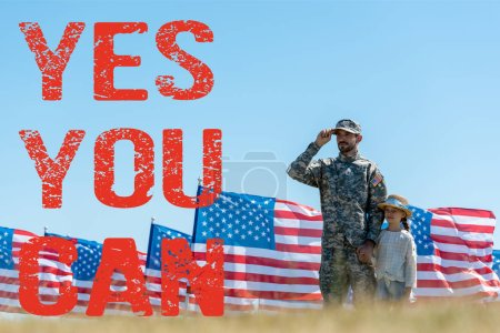 Photo for Selective focus of father in military uniform standing with cute kid near american flags with yes you can illustration - Royalty Free Image