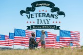 "Постер, картина, фотообои ""selective focus of military father holding hands with cute kid near american flags with happy veterans day, honoring all who served illustration """