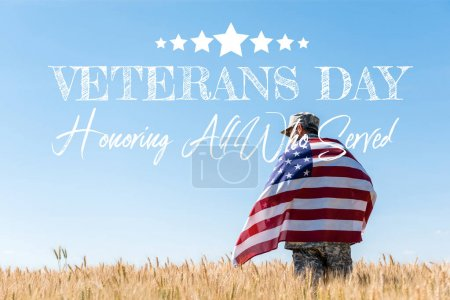 Photo for Soldier in cap and military uniform holding american flag in golden field with veterans day, honoring all who served illustration - Royalty Free Image