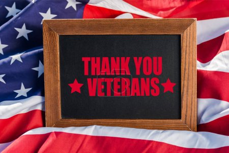 Photo for Chalkboard  with thank you veterans illustration on american flag with stars and stripes - Royalty Free Image