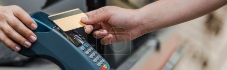 Photo for Panoramic shot of man paying by credit card near cashier in supermarket - Royalty Free Image