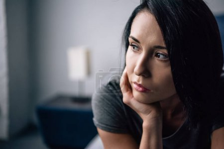 Photo for Selective focus of beautiful depressed woman looking away at home - Royalty Free Image