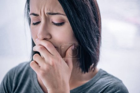 Photo for Beautiful sad woman covering mouth at home - Royalty Free Image