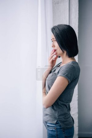 Photo for Beautiful upset woman covering mouth at home with copy space - Royalty Free Image