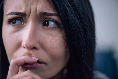 Photo for Beautiful upset woman covering mouth at home and looking away - Royalty Free Image