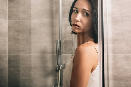 Photo pour Beautiful lonely depressed woman in shower with copy space - image libre de droit