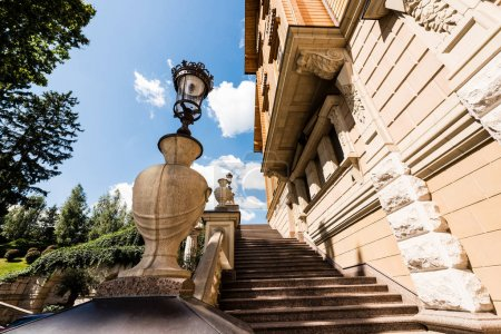 Photo pour Low angle view of stairs and street lamp near house - image libre de droit