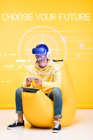 man on bean bag chair in virtual reality headset on yellow with cyberspace illustration and choose your future lettering
