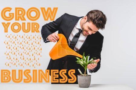 Photo pour Homme d'affaires en costume arrosage arbre d'argent isolé sur gris avec croître votre illustration d'entreprise - image libre de droit
