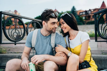 Photo for Asian woman and handsome man hugging and looking at each other - Royalty Free Image
