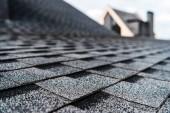 "Постер, картина, фотообои ""selective focus of grey shingles on rooftop of building """