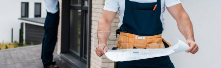 Photo for Panoramic shot of architect holding blueprint near coworker - Royalty Free Image