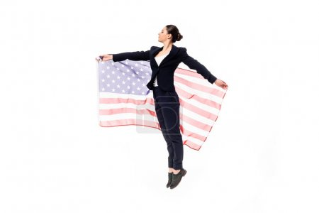 Photo for Attractive businesswoman dancing while holding united states national flag isolated on white - Royalty Free Image