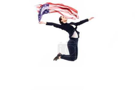 Photo for Young businesswoman jumping in dance while holding usa national flag isolated on white - Royalty Free Image