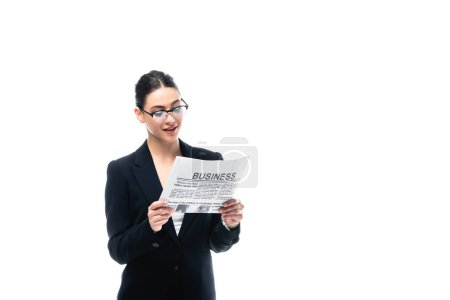 Photo for Elegant businesswoman in glasses reading business newspaper isolated on white - Royalty Free Image