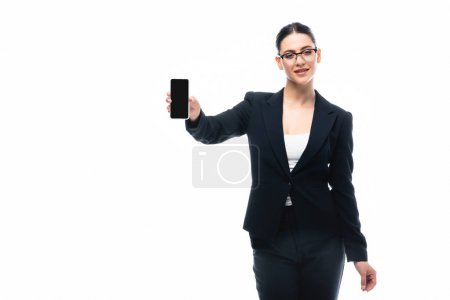 Photo for Attractive businesswoman showing smartphone with blank screen isolated on white - Royalty Free Image