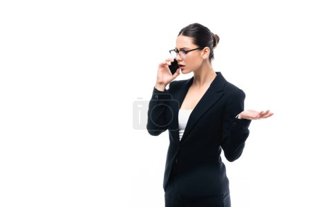 dissatisfied businesswoman gesturing while talking on smartphone isolated on white