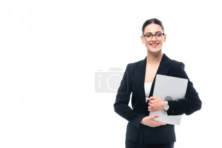 Photo for Cheerful businesswoman holding laptop and smiling at camera isolated on white - Royalty Free Image