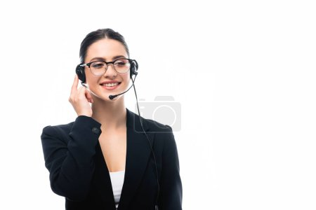 cheerful call center operator in headset smiling while looking away isolated on white