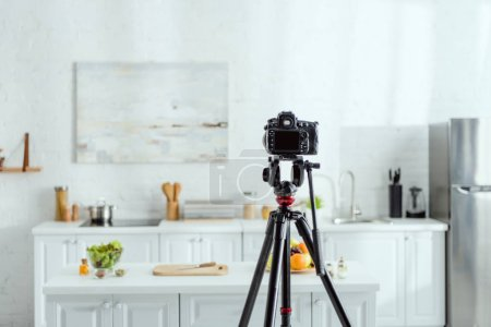 Photo for Selective focus of digital camera on tripod in modern kitchen - Royalty Free Image