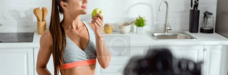 Photo for Panoramic shot of happy woman smelling tasty apple - Royalty Free Image