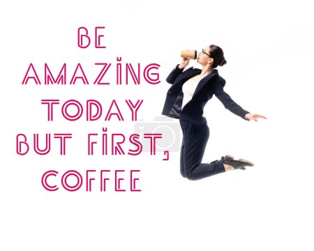 Photo for Young businesswoman jumping while drinking coffee to go near be amazing today but first, coffee lettering isolated on white - Royalty Free Image