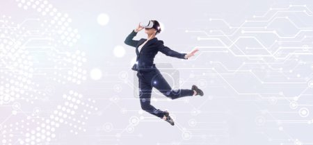 Photo for Panoramic shot of businesswoman in virtual reality headset levitating on grey background with abstract cyberspace illustration - Royalty Free Image