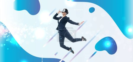 Photo for Young businesswoman in virtual reality headset levitating on grey background with blue and white abstract cyberspace illustration - Royalty Free Image