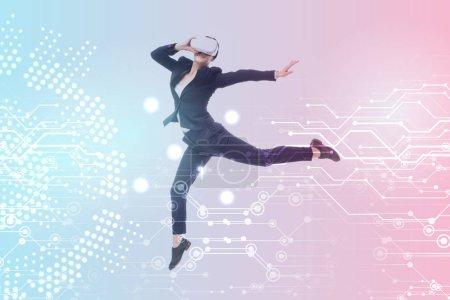 Photo for Young businesswoman in virtual reality headset levitating on blue and pink gradient background with cyberspace illustration - Royalty Free Image