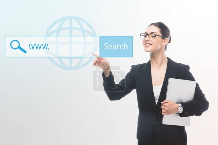 Photo for Smiling businesswoman pointing with finger at search field illustration on grey background - Royalty Free Image