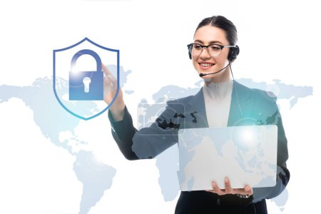 Photo pour Call center operator holding laptop while pointing with finger at safety lock icon near world map isolated on white - image libre de droit