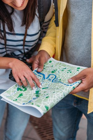 Photo for Cropped view of tourists holding and pointing with finger at map - Royalty Free Image
