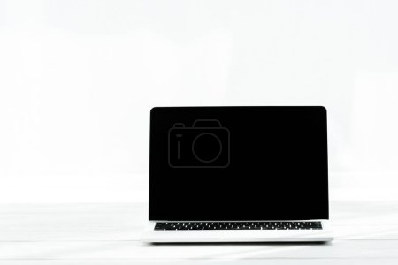 Photo for Modern laptop with blank screen on wooden table on white - Royalty Free Image