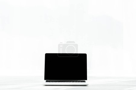 Photo for Modern laptop with blank screen on wooden desk on white - Royalty Free Image