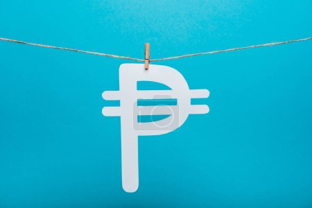 Photo for Cloth pin on line rope near russian money sign on blue - Royalty Free Image