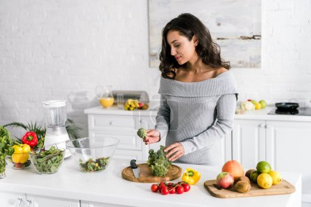 Photo for Young attractive woman preparing salad at home - Royalty Free Image
