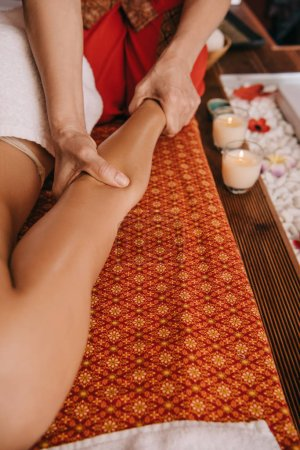 Photo for Cropped view of masseur doing hand massage to woman in spa salon - Royalty Free Image