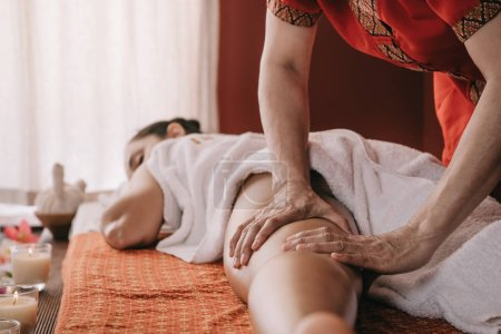 Photo for Cropped view of masseur doing foot massage to woman in spa salon - Royalty Free Image