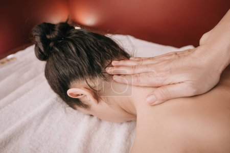 Photo for Cropped view of masseur doing neck massage to woman in spa salon - Royalty Free Image