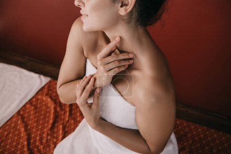 Photo for Cropped view of woman in white towel sitting on massage mat - Royalty Free Image