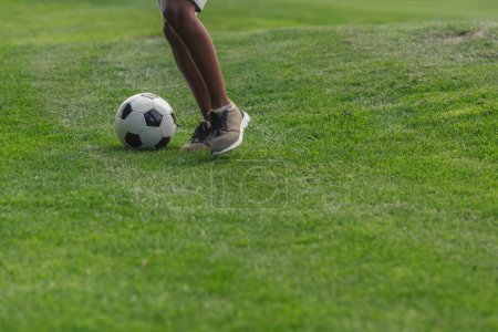 cropped view of african american boy playing football