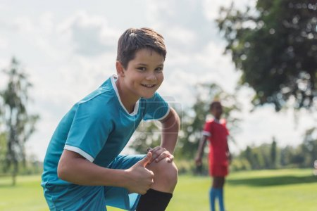 Photo for Selective focus of happy kid in sportswear showing thumb up - Royalty Free Image