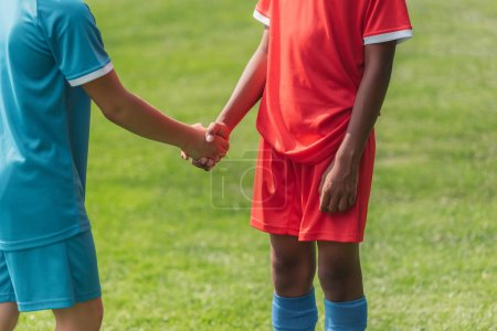 Photo for Cropped view of multicultural kids shaking hands - Royalty Free Image