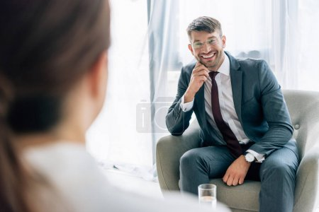 Photo for Selective focus of journalist talking with handsome businessman in suit and glasses - Royalty Free Image