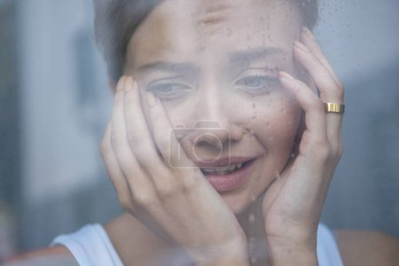 Photo for Selective focus of upset young woman crying at home - Royalty Free Image