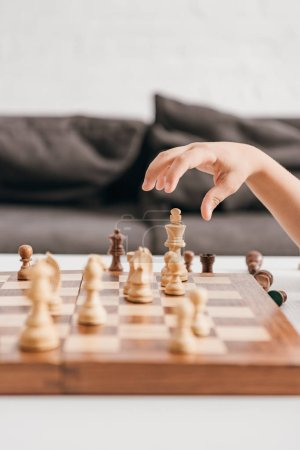 Photo for Partial view of boy playing chess at home - Royalty Free Image