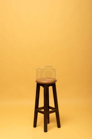 brown wooden chair isolated on yellow