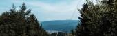 """Постер, картина, фотообои """"панорамный снимок деревьев возле гор на фоне голубого неба с облаками"""""""